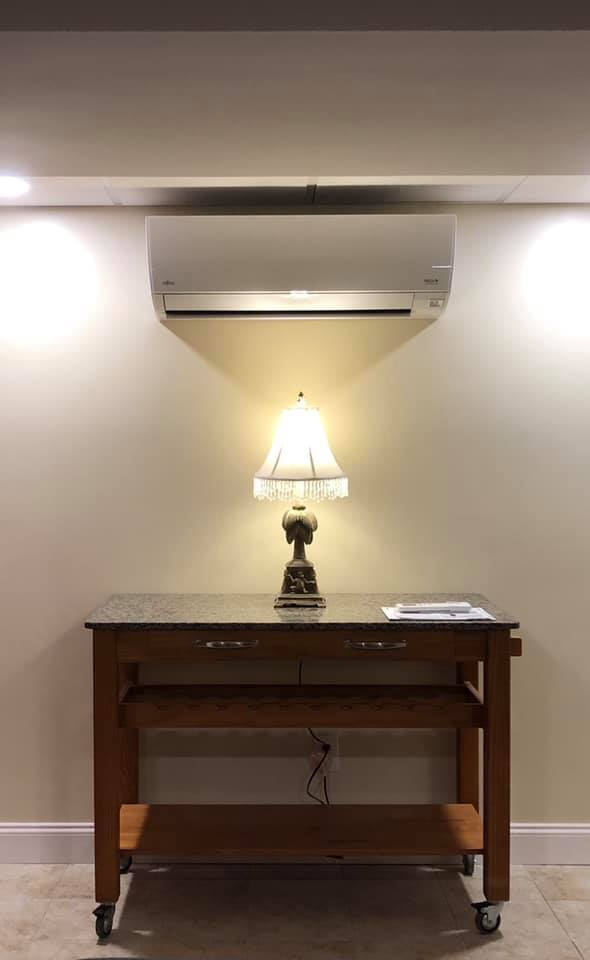 Wall-Mount Heat Pump Above Lamp