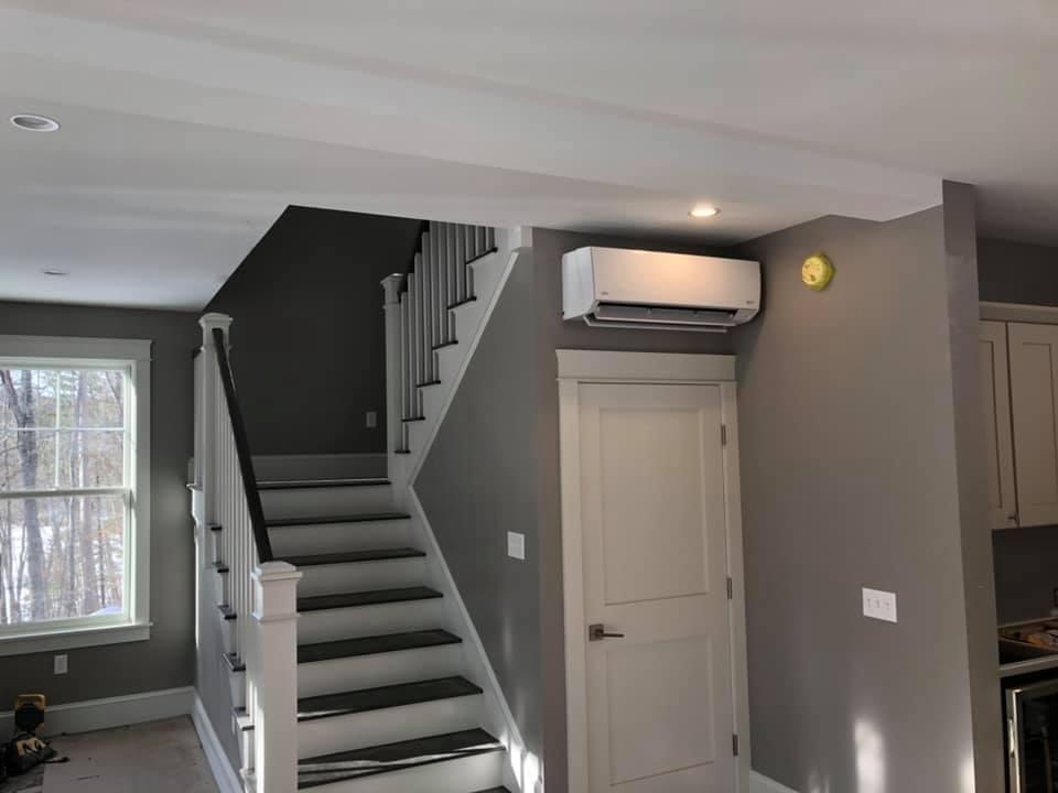 Wall-mount Heat Pump near staircase